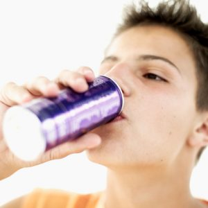 close-up of a teenage boy (16-17) drinking from a can